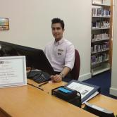 Daniel Molina, Communication & Information (Masters Student, Information), Working the FIU Law library circulation desk
